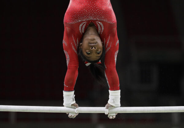 United States' Simone Biles trains on the uneven bars ahead of the 2016 Summer Olympics in Rio de Janeiro, Brazil, Thursday, Aug. 4, 2016. (AP Photo/Rebecca Blackwell)
