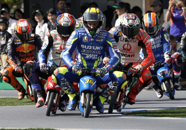 epaselect epa07926554 Spanish MotoGP rider Joan Mir (R) of Team Suzuki Ecstar and other MotoGP racers ride mini electric motorcycles at a fan event at Twin Ring Motegi in Motegi, Japan, 17 October 2019. The event was held ahead of the MotoGP race of Japan's Motorcycling Grand Prix scheduled for 20 October 2019.  EPA-EFE/TORU HANAI